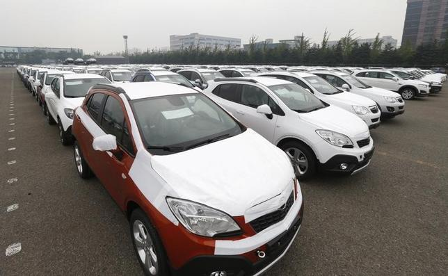 Cars made by GM Korea are seen in a yard of GM Korea's Bupyeong plant before they are transported to a port for export, in Incheon, west of Seoul August 9, 2013.  REUTERS/Lee Jae-Won