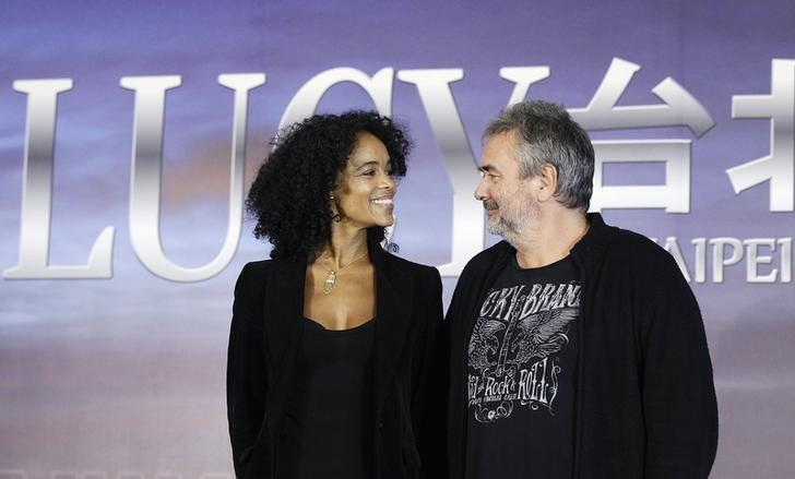 French film director Luc Besson (R) and his wife and producer Virginie Silla smile at each other during a news conference for his movie ''Lucy'' in Taipei November 1, 2013. REUTERS/Pichi Chuang/Files