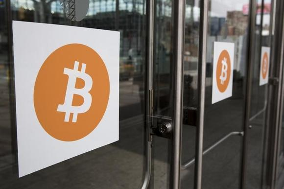 Bitcoin themed stickers stand attached to glass doors during the Inside Bitcoins: The Future of Virtual Currency Conference in New York April 8, 2014. REUTERS/Lucas Jackson/Files