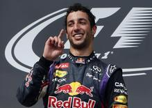 Winner Red Bull Formula One driver Daniel Ricciardo of Australia celebrates on the podium after the Hungarian F1 Grand Prix at the Hungaroring circuit, near Budapest July 27, 2014.  REUTERS/Bernadett Szabo