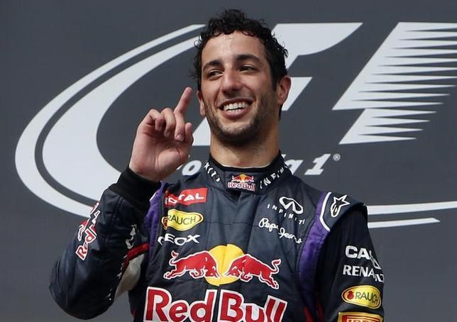 Winner Red Bull Formula One driver Daniel Ricciardo of Australia celebrates on the podium after the Hungarian F1 Grand Prix at the Hungaroring circuit, near Budapest July 27, 2014.  REUTERS/Bernadett Szabo