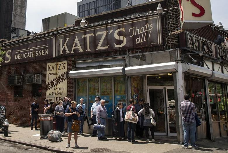 People stand in line at Katz's Delicatessen, the famous deli founded in 1888, in New York's lower East Side June 13, 2014. REUTERS/Brendan McDermid