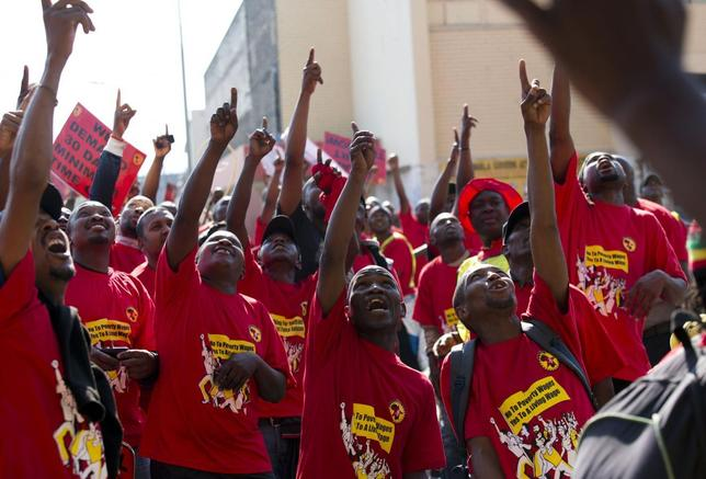 Members of the National Union of Metal Workers of South Africa (NUMSA) point at workers at a construction site not taking part in the strike during a protest on the streets of Durban July 1, 2014. REUTERS/Rogan Ward
