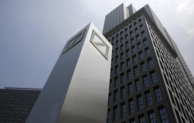 Logos of Deutsche Bank AG are seen in Tokyo July 16, 2014.  REUTERS/Toru Hanai