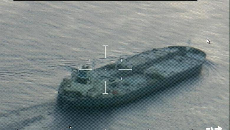 A still image from video taken by a U.S. Coast Guard HC-144 Ocean Sentry aircraft shows the oil tanker United Kalavyrta (also known as the United Kalavrvta), which is carrying a cargo of Kurdish crude oil, approaching Galveston, Texas July 25, 2014.  REUTERS/US Coast Guard/handout via Reuters