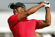 Tiger Woods of the U.S. watches his tee shot on the third hole during the final round of the British Open Championship at the Royal Liverpool Golf Club in Hoylake, northern England July 20, 2014. REUTERS/Phil Noble