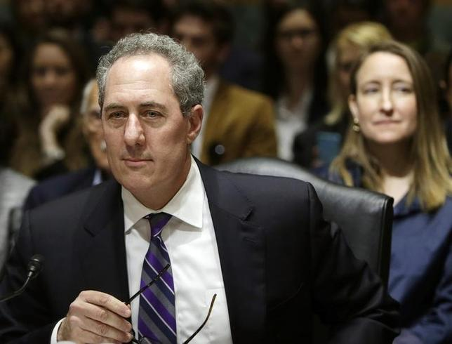 United States Trade Representative Michael Froman (L) awaits to testify before the Senate Finance Committee on President Barack Obama's 2014 Trade Policy Agenda on Capitol Hill in Washington May 1, 2014. Froman's wife, Nancy Goodman, is at right. REUTERS/Gary Cameron