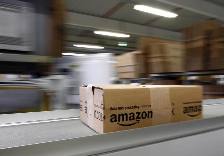 A parcel moves on the conveyor belt at Amazon's logistics centre in Graben near Augsburg December 16, 2013. REUTERS/Michaela Rehle/Files