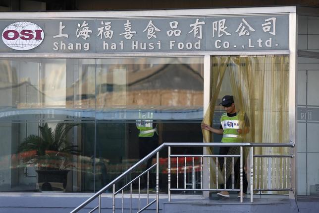 A man walks out of the entrance of Husi Food factory in Shanghai July 23, 2014. REUTERS/Aly Song