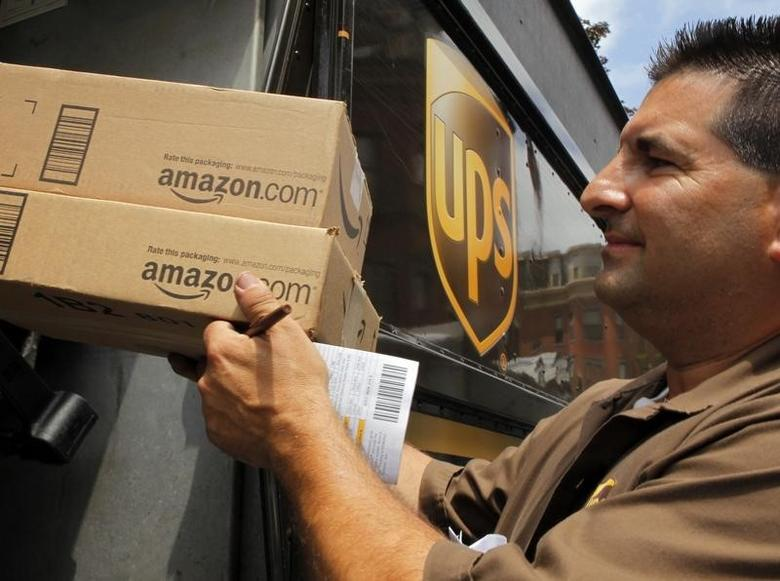 UPS driver T.J. Dellasala delivers two packages from Amazon.com in Boston, Massachusetts July 26, 2011. REUTERS/Brian Snyder/Files