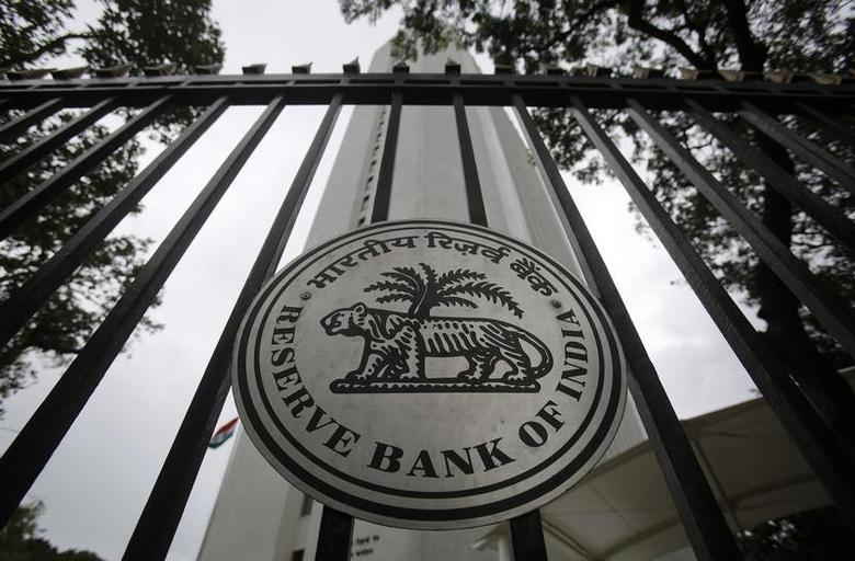 The Reserve Bank of India (RBI) seal is pictured on a gate outside the RBI headquarters in Mumbai July 30, 2013. REUTERS/Vivek Prakash/Files