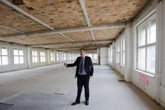 George Darbishire of Ziegert Property stands in a floor of the Metropolis Park development that will be turned into a loft in Berlin June 26, 2014. REUTERS/Thomas Peter