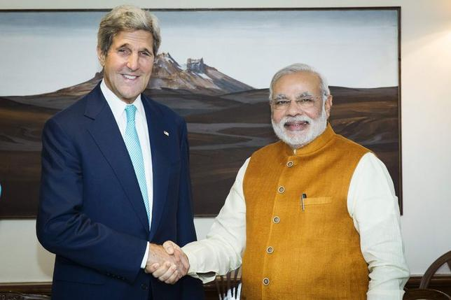 U.S. Secretary of State John Kerry (L) shakes hands with Indian Prime Minister Narendra Modi at the Prime Minister's residence in New Delhi August 1, 2014. REUTERS/Lucas Jackson