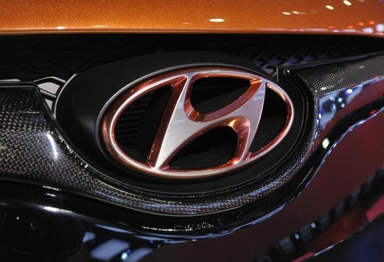 Detail view of the Hyundai logo on their Veloster model shown during the final press preview day for the North American International Auto Show in Detroit, Michigan, January 10, 2012. REUTERS/Mike Cassese