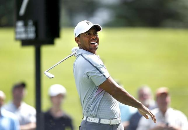 Jul 31, 2014; Akron, OH, USA; Tiger Woods reacts to his tee shot on the seventh hole during the first round of the WGC-Bridgestone Invitational golf tournament at Firestone Country Club - South Course. Mandatory Credit: Joe Maiorana-USA TODAY Sports