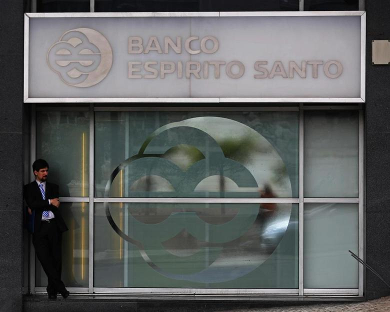A man passes by an office of Portuguese bank Banco Espirito Santo (BES) in downtown Lisbon August 1, 2014. REUTERS/Hugo Correia