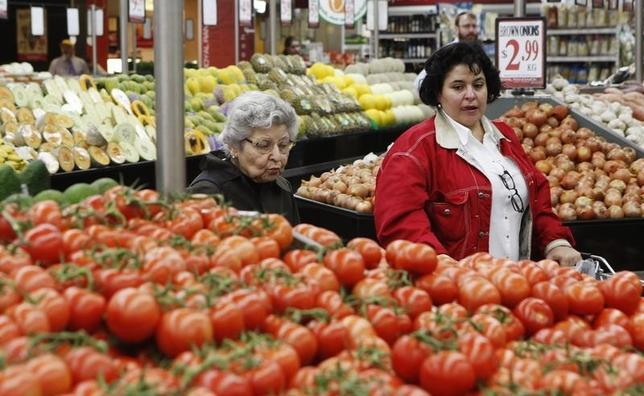 Two women look at tomatoes in the fruits and vegetables section at a supermarket in Sydney April 27, 2011. REUTERS/Daniel Munoz
