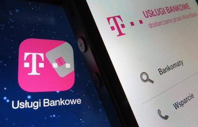 Mobile phone (R) displaying an open T-mobile banking service application lies on a tablet screen with the same icon in this illustration picture taken in Warsaw June 17, 2014. REUTERS/Kacper Pempel