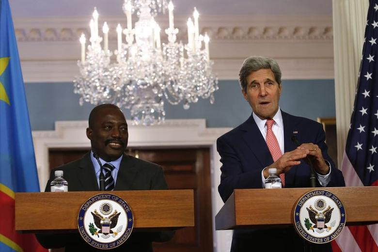 U.S. Secretary of State John Kerry (R) meets with President of the Democratic Republic of Congo Joseph Kabila at the State Department in Washington, August 4, 2014. REUTERS/Yuri Gripas