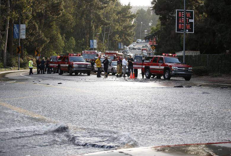 Emergency crews line Sunset Boulevard at the Westwood Plaza intersection after a broken thirty inch water main gushed water onto Sunset Boulevard near the UCLA campus in the Westwood section of Los Angeles July 29, 2014.   REUTERS/Danny Moloshok