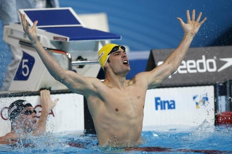 Australia's Christian Sprenger reacts upon winning the men's 100m breaststroke final during the World Swimming Championships at the Sant Jordi arena in Barcelona July 29, 2013.   REUTERS/Albert Gea
