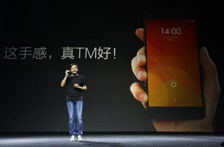 Lei Jun, founder and CEO of China's mobile company Xiaomi, speaks at a launch ceremony of Xiaomi Phone 4, in Beijing, July 22, 2014. REUTERS/Jason Lee