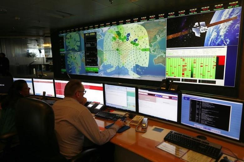 Staff at satellite communications company Inmarsat work in front of a screen showing subscribers using their service throughout the world, at their headquarters in London March 25, 2014.  REUTERS/Andrew Winning