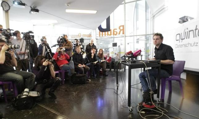 Law student Max Schrems (R) briefs the media in Vienna February 7, 2012. REUTERS/Herwig Prammer/Files