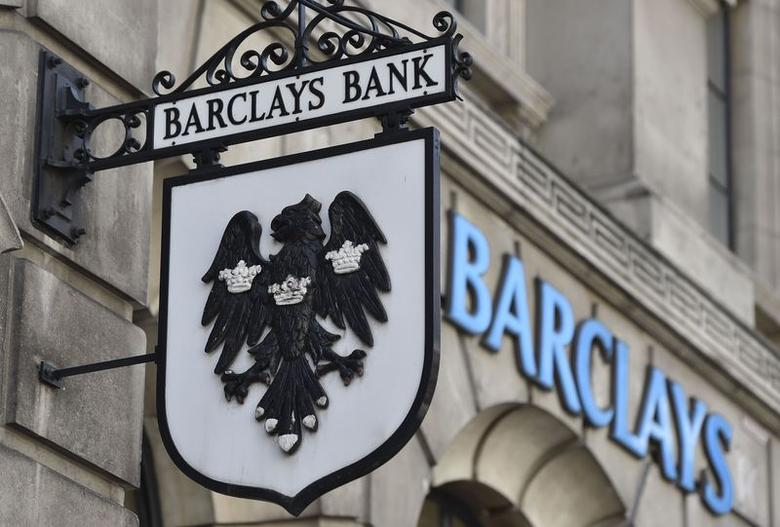 A Barclays sign hangs outside a branch of the bank in the City of London July 30, 2014.  REUTERS/Toby Melville