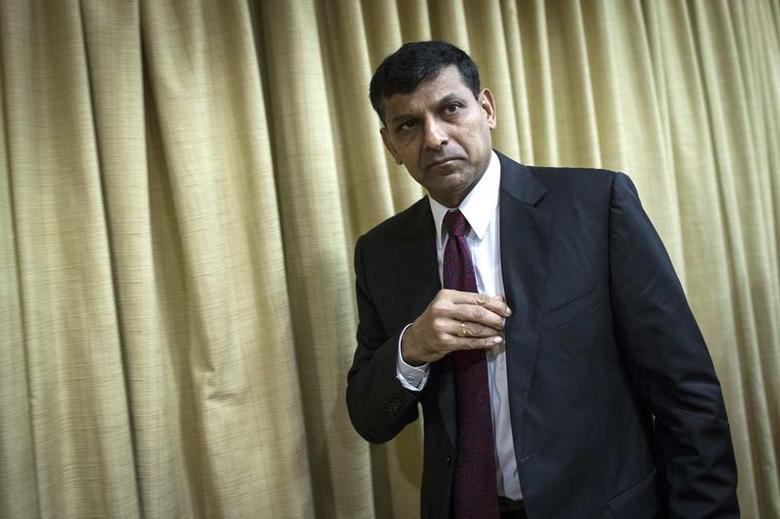 The Reserve Bank of India (RBI) Governor Raghuram Rajan leaves after attending a news conference during the bi-monthly monetary policy review in Mumbai August 5, 2014. REUTERS/Danish Siddiqui