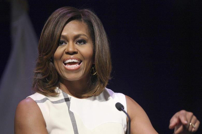 U.S. first lady Michelle Obama gives a keynote speech to the Unite For Veterans Summit in Los Angeles, California, July 16, 2014. Obama is on a two-day swing through the Los Angeles area.  REUTERS/David McNew (UNITED STATES - Tags: POLITICS HEADSHOT)