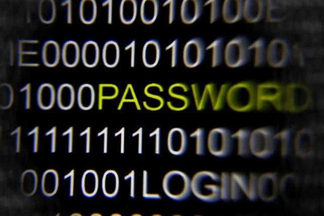 The word 'password' on a computer screen is magnified with a magnifying glass in this picture illustration taken in Berlin May 21, 2013. REUTERS/Pawel Kopczynski/Files