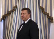 Then Ukrainian President Viktor Yanukovich arrives to sign an EU-mediated peace deal with opposition leaders at the presidential headquarters in Kiev in this February 21, 2014 file photo. REUTERS/Konstantin Chernichkin/Files