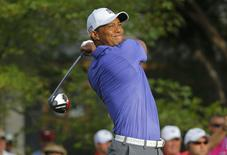 Tiger Woods of the U.S. tees off on the tenth hole during the first round of the 2014 PGA Championship at Valhalla Golf Club in Louisville, Kentucky, August 7, 2014. REUTERS/Brian Snyder