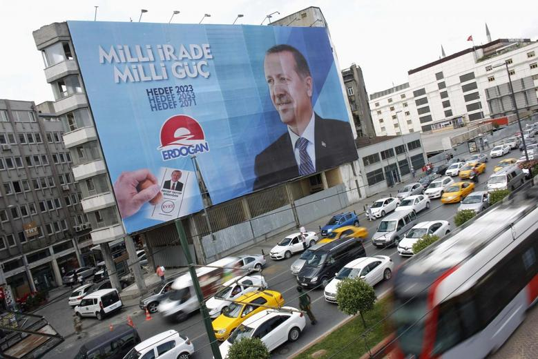 A huge election campaign banner of Turkey's Prime Minister and presidential candidate Tayyip Erdogan hangs on a building in Istanbul August 7, 2014.  REUTERS/Murad Sezer