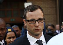 Paralympic track star Oscar Pistorius leaves after listening to the closing arguments in his murder trial at the high court in Pretoria August 7, 2014.  REUTERS/Siphiwe Sibeko