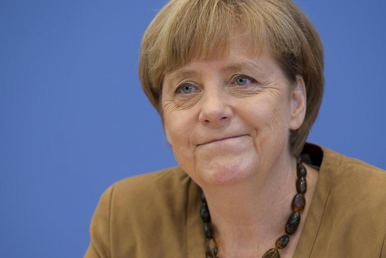 German Chancellor Angela Merkel smiles during a press conference in Berlin, July 18, 2014.  REUTERS/Axel Schmidt