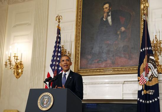 U.S. President Barack Obama talks about the humanitarian relief situation in Iraq inside the State Dining Room of the White House in Washington, August 7, 2014.        REUTERS/Larry Downing