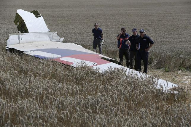 Members of a group of international experts inspect wreckage at the site where the downed Malaysia Airlines flight MH17 crashed, near the village of Hrabove (Grabovo) in Donetsk region, eastern Ukraine August 1, 2014. REUTERS/Sergei Karpukhin