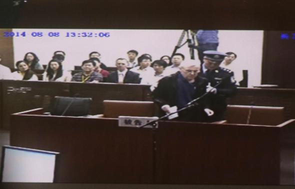 An internal court video shows British investigator Peter Humphrey arriving at a courtroom after a lunch break, during his trial at Shanghai No. 1 Intermediate People's Court August 8, 2014. REUTERS-Carlos Barria
