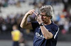 Técnico do Manchester City Manuel Pellegrini em Abu Dhabi. 14/05/2014 REUTERS/Stringer