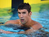 Aug 6, 2014; Irvine, CA, USA; Michael Phelps reacts after placing seventh in the 100m freestyle in the 2014 USA National Championships at William Woollett Jr. Aquatics Complex. Mandatory Credit: Kirby Lee-USA TODAY Sports - RTR41I9M