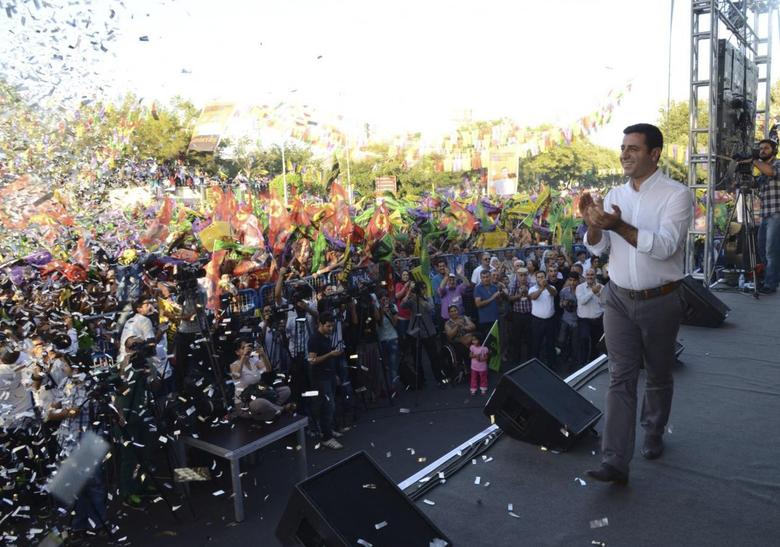 Selahattin Demirtas, co-chairman of the pro-Kurdish Peoples' Democracy Party (HDP) and presidential candidate, speaks during an election rally in Diyarbakir, August 8, 2014. REUTERS/Stringer