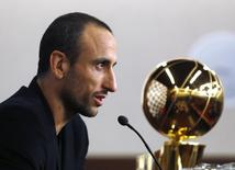 San Antonio Spurs guard Manu Ginobili of Argentina speaks during a news conference upon his arrival at the airport in Buenos Aires July 4, 2014. REUTERS/Enrique Marcarian