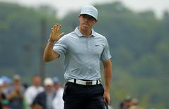 Rory McIlroy of Northern Ireland reacts after sinking a birdie putt on the ninth hole during the second round of the 2014 PGA Championship at Valhalla Golf Club in Louisville, Kentucky, August 8, 2014. REUTERS/Brian Snyder
