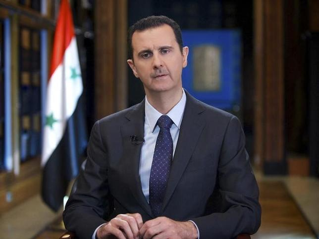 Syria's President Bashar al-Assad speaks during an interview with Venezuelan state television TeleSUR in Damascus, in this handout photograph distributed by Syria's national news agency SANA on September 26, 2013.      REUTERS/SANA/Handout via Reuters