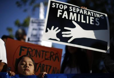 Obama vow to speed deportation of children at odds...