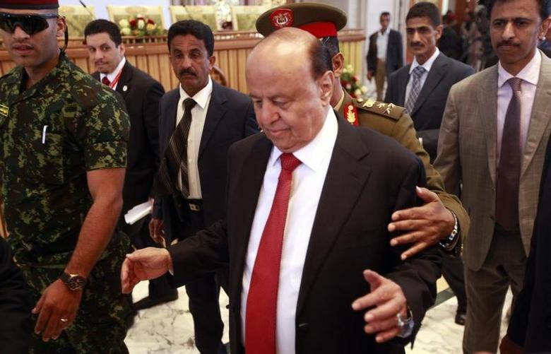 Yemen's President Abd-Rabbu Mansour Hadi enters the hall  during the closing ceremony of the Yemeni national dialogue conference in Sanaa January 25, 2014. REUTERS/Mohamed al-Sayaghi