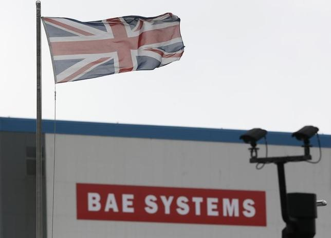 A union flag flies over the entrance to the naval dockyards, where BAE Systems are also located, in Portsmouth, southern England November 6, 2013.  REUTERS/Stefan Wermuth