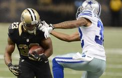 Nov 10, 2013; New Orleans, LA, USA; New Orleans Saints running back Pierre Thomas (23) gets face masked by Dallas Cowboys cornerback Orlando Scandrick (32) during the second quarter at Mercedes-Benz Superdome. John David Mercer-USA TODAY Sports - RTX158OU